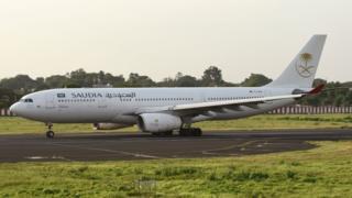 A Saudi Arabia Airlines plane on the runway