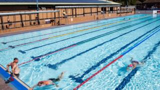 Swimmers enjoy the pool at Woodgreen Leisure Centre, Oxfordshire