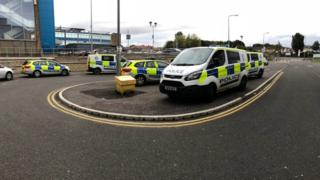 Police vehicles outside Victoria Hospital in Kirkcaldy