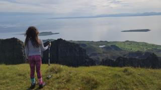 Ava looking down on her home from Quiraing on Skye