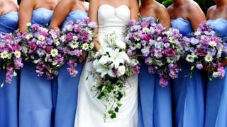 A row of bridesmaids and a bride