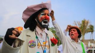 People dressed as clowns protest on the main avenues in Acapulco, Guerrero, Mexico, 07 May 2018.