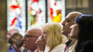 Churchgoers during a service for Jo Cox at St Peter's Church in Birstall