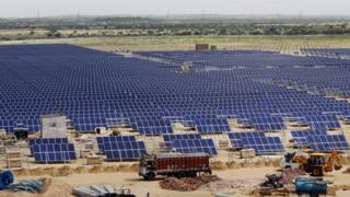 Solar panels at the under construction Roha Dyechem solar plant at Bhadla