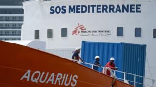 Workers on board Aquarius in dock