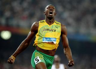 Usain Bolt of Jamaica reacts after breaking the world record