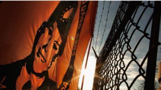 флаг с изображением Мэннинга