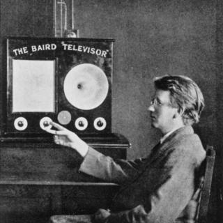"John Logie Baird with his invention, the ""Televisor"""