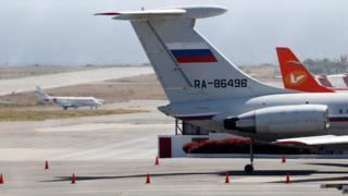 An airplane with the Russian flag is seen at Simon Bolivar International Airport in Caracas