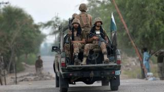 Pakistani troops patrol in the village of Ghundai in Khyber tribal district on July 18, 2014