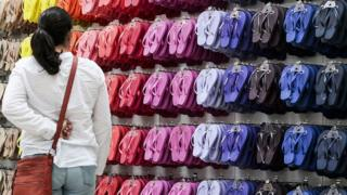 Havaianas, lined up in all colours of the rainbow