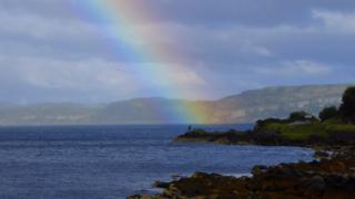 Fisherman and rainbow in Kilchatten Bay