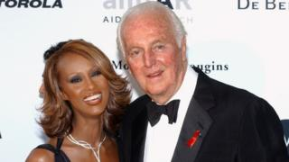 French fashion designer Hubert de Givenchy pictured with Somali-born model Iman in May 2002