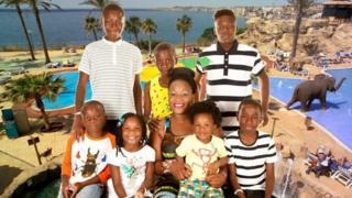 Alina Joseph with her children Christian, Daniel, Glody, Harley, Christopher, Blessing, Isaac