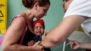 A baby receives a vaccination against yellow fever, at Mairipora municipality, in Sao Paulo, Brazil, 19 January 2018.