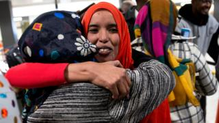 Zaura Warsma (L) welcomes her daughter Najma Abdishakur (R), a Somali national who was denied entry under the Trump administration travel ban, after she cleared customs at Washington Dulles International Airport in Chantilly, Virginia, USA, 06 February 2017.