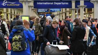 Passengers queuing at London St Pancras station