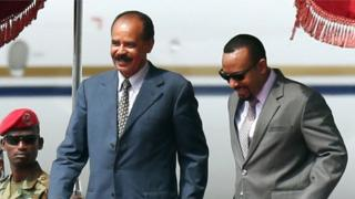 Eritrea's President Isaias Afwerki is welcomed by Ethiopian Prime Minister Abiy Ahmed upon arrival in Addis Ababa, 14 July 2018