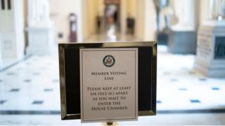 A sign in Congress mandates social distancing for lawmakers