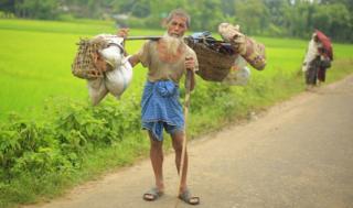 After leaving everything else in Myanmar, Rohingya Abu Tabel arrives in Bangladesh with the last of his belongings