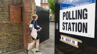 Woman walking into a polling station