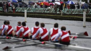 Spectators watch Henley regatta from the riverbank