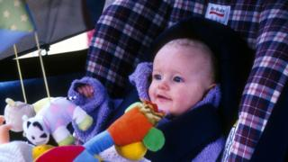 Stock photo of child in car seat
