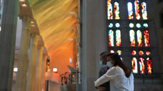 People hug each other in the basilica of the Sagrada Familia in Barcelona, ​​Spain, 4 July 2020