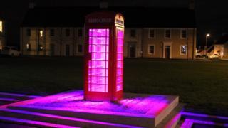 Lit telephone box in Chapelton by Lighting Design International
