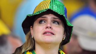 A fan cries after a Brazil defeat