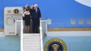 President Trump and his wife Melania on the steps of Air Force One