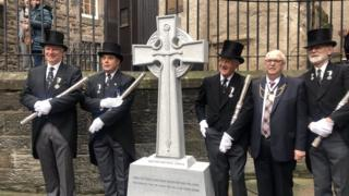 The cross being unveiled in Edinburgh