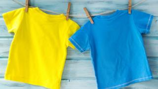 Coloured T shirts on a washing line.