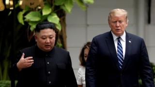 Kim Jong-un and Donald Trump talking in Hanoi