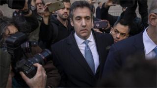 Michael Cohen leaves court