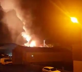 Fire and smoke erupting from an industrial building