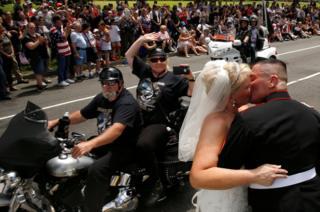 Tim Chambers (right) kisses his new bride Lorraine Heist