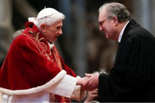 Pope Benedict XVI is greeted by Matthew Festing, Grand Master of the Sovereign Order of Malta, during a mass at the Vatican on February 9, 2013.