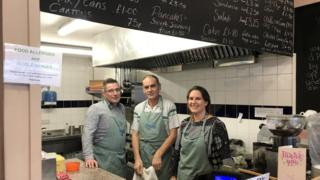 Johanna Simic with two kitchen volunteers
