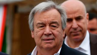 UN Secretary-General Antonio Guterres (C) delivers a speech during his visit to the Hasan Sham Camp, for Iraqis displaced by fighting with jihadists, on March 31, 2017,