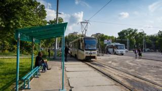 Passengers wait for a tram in Tashkent.