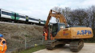 Digger next to railway line