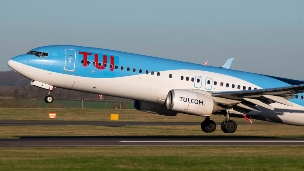 positive people Tui flight landing in Cardiff