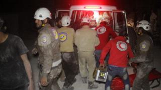 Members of the Syrian Arab Red Crescent and Civil Defence help a wounded victim into the back of an ambulance following Russian air strikes that targeted many areas in Idlib, Syria, on 31 May