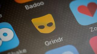 Stock image of Grindr on phone screen