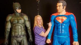 Cake maker with Batman and Superman cakes