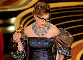 Ruth Carter accepts her Oscar