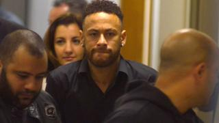Brazilian football player Neymar leaves a police station after testifying in Rio de Janeiro, Brazil, 6 June