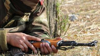 A soldier with a gun in Kashmir