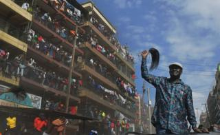 "Kenya""s opposition leader Raila Odinga arrives in the Mathare district of Nairobi on August 13, 2017. Kenya""s defeated opposition leader Raila Odinga on August 13 urged his supporters to boycott work, promising to announce on August 15 his strategy after an election he claims was stolen from him"